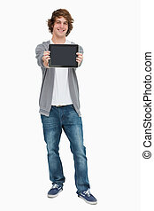 Male student showing a touch pad screen against white...