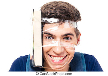 Male student with book strapped to his head