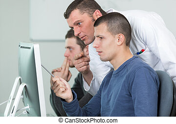 male students solving problems on the computer