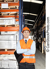 Male Supervisor With Arms Crossed At Warehouse