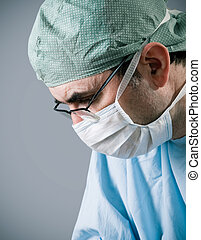 surgeon - Male surgeon in scrubs uniform