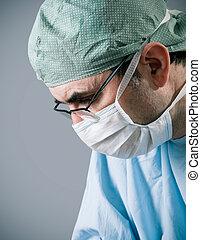 surgeon - Male surgeon in scrubs uniform