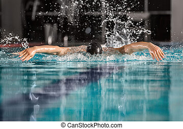 Male swimmer swimming the butterfly stroke