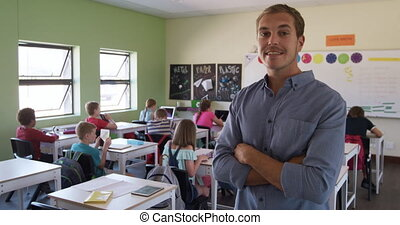 Male teacher smiling in the class - Caucasian male teacher ...