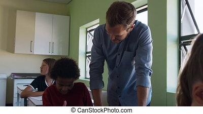 Male teacher teaching in the class - Caucasian male teacher ...