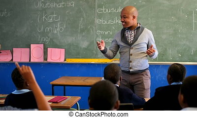 Male teacher teaching students in the classroom 4k - Male ...