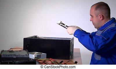 Male technician engineer man install pc motherboard in black...