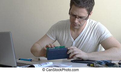 Male technician fixing lan switch