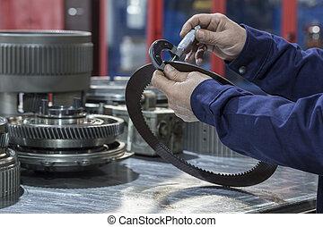 male technician preparing equipment in a service