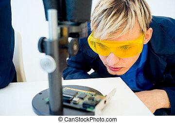 Male technician repairing a computer
