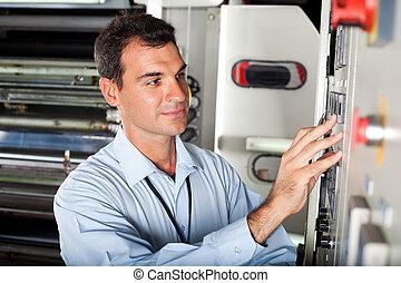 technician setting industrial machine