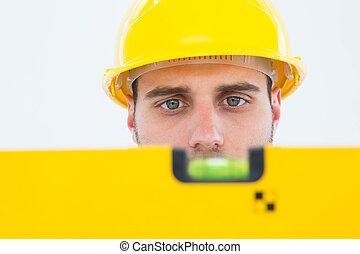 Male technician using spirit level - Close-up of male ...
