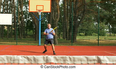 Male tennis player playing match on hardcourt