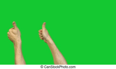 Male thumbs on green background - Footage of male hands on...