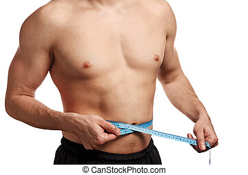 Male torso with measure tape on waistline over white...