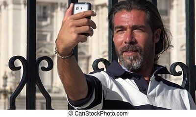 Male Tourist Taking Selfy