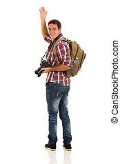 male tourist waving goodbye
