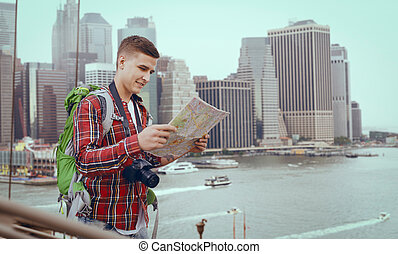 Male tourists study the map of city attractions
