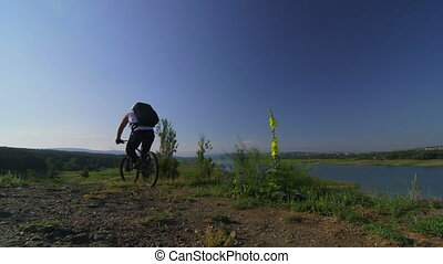 Male traveler riding mountain bike