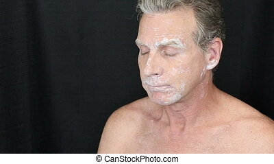Male Turning to Each Side as a Bentonite Face Mask Dries