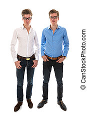 Male twins with white and blue blouse standing together