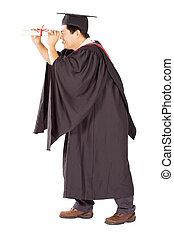 university graduate looking through certificate