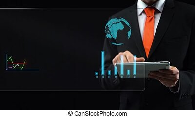 Male uses holographic interface, in black suit working with a tablet, then turn-on touchscreen then appears financial chart and diagrams.