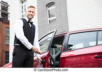 Male Valet Opening Car Door - Portrait Of A Handsome Young...