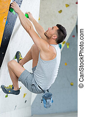 male wall climber on the move