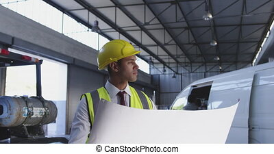 Male warehouse manager holding plan 4k - Close up side view ...