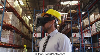 Male warehouse manager in VR goggles 4k