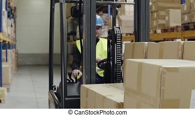 Male warehouse worker with forklift. - Man forklift driver...