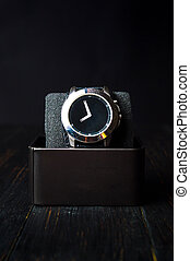 Male watch in a box on dark background