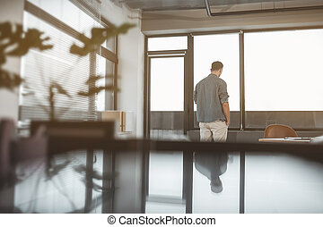Male watching at street in office