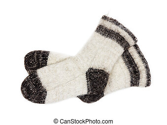 male white knitted socks of dog fur on white background close-up, top view
