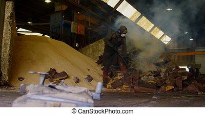 Male worker breaking hot mold in foundry workshop 4k - Male ...