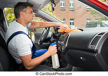 Male Worker Cleaning Car Interior