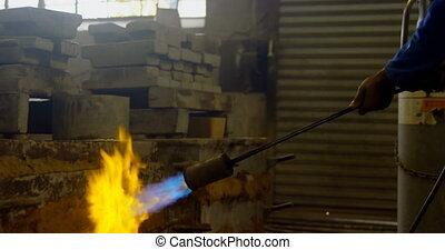 Male worker heating molds in workshop 4k - Male worker ...