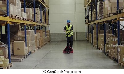 Male worker in a warehouse. - Young male worker in a...