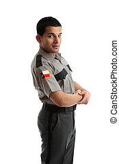 Male worker in uniform standing sideways