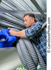 male worker installing a cooling system