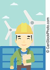 Male worker of solar power plant and wind farm. - An asian...