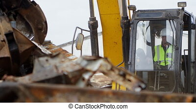 Male worker operating excavator machine 4k