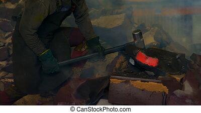 Male worker pushing metal casting in workshop 4k - Male ...