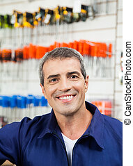 Male Worker Smiling In Hardware Shop