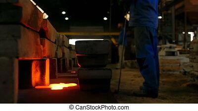 Male worker standing near mould in workshop. Molted metal in workshop 4k
