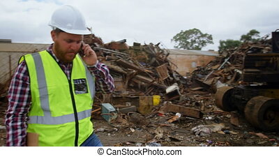 Male worker talking on mobile phone 4k - Male worker talking...
