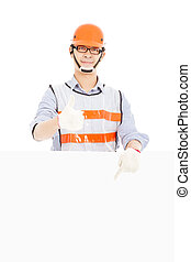 Male worker  thumb up gesture and pointing to  white board