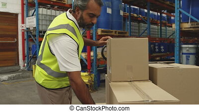 Male worker using barcode scanner in a warehouse