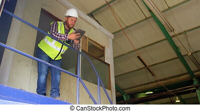 Male worker using digital tablet 4k